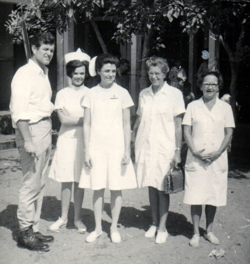 Ted Kennedy stands next to Maureen Orr and Carol Portner (L-R) during a visit Kennedy made to their hospital in Nha Trang, Vietnam.