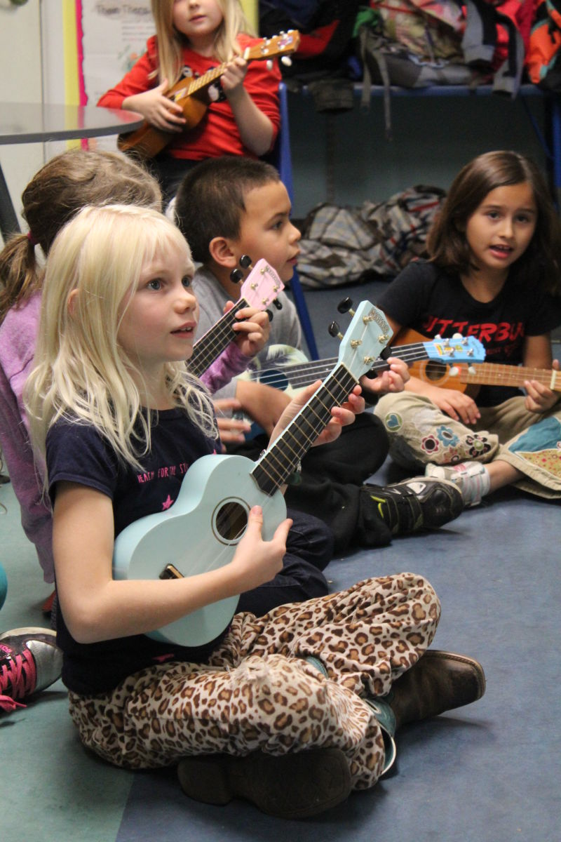 Kids at the Lake County International Charter School in Middletown practicing singing and ukulele.