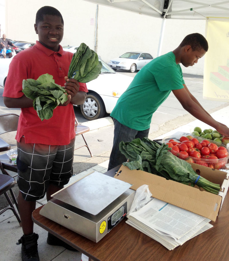 Twin brothers Dayvon and Dashon Standifer sell produce they grew themselves.
