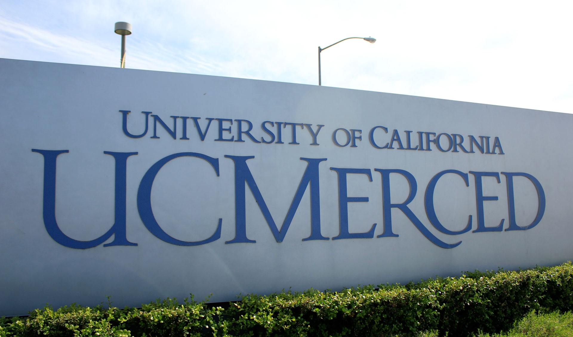 A sign marking the entrance to UC Merced.