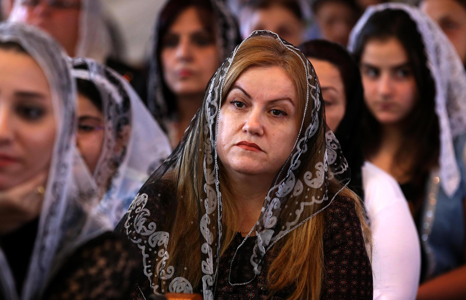 Iraqi Assyrian Christians attend a ceremony at Saint Youhanna church in Arbil, the capital of the autonomous Kurdish region of northern Iraq on September 18, 2015.