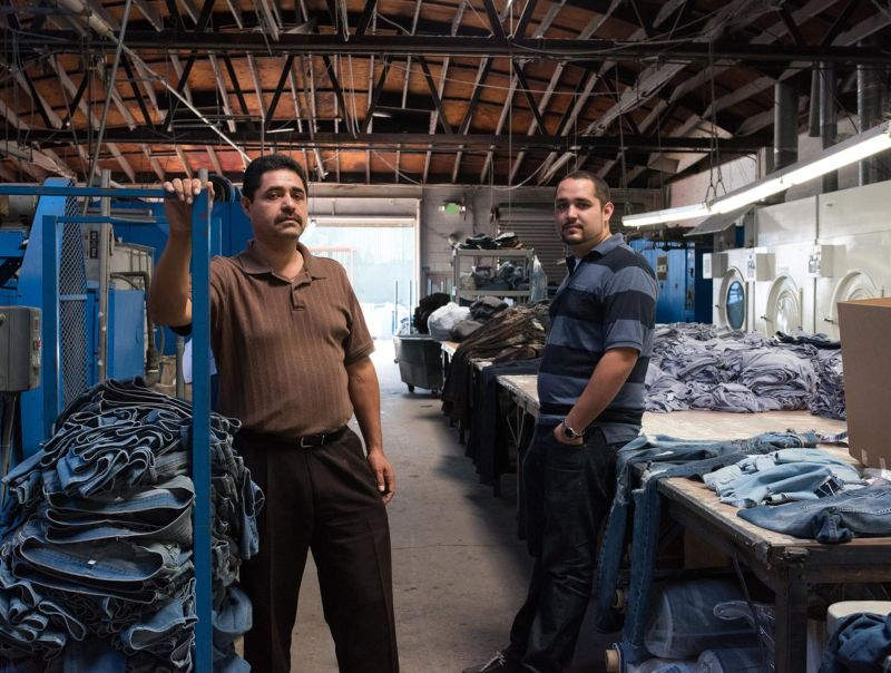 Raul Quintero (L) and his son Oscar, owners of Blue Creations, at their factory.