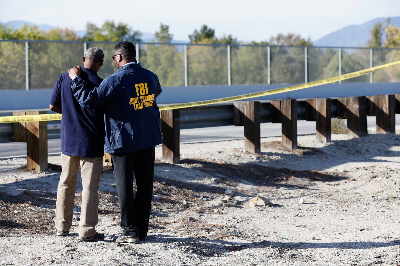The FBI also responded to the scene. Here, members of the Joint Terrorism Task Force stand outside a press conference about the shooting.