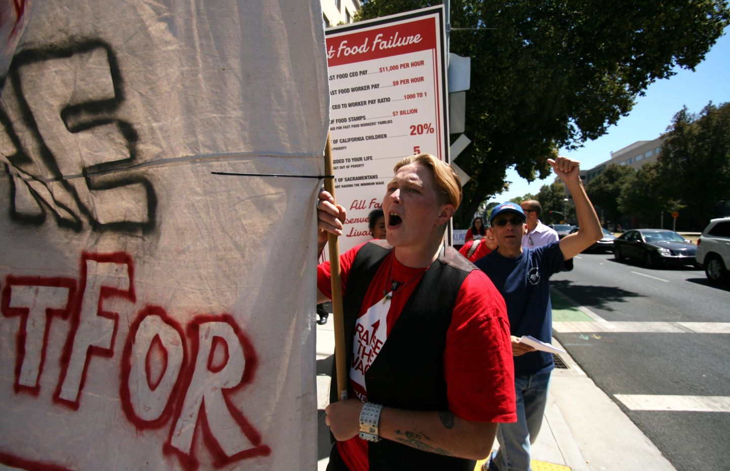 Fast-food workers with the Fight for $15 movement rallied in Sacramento for higher wages in August 2015. Pauline Bartolone/CALmatters