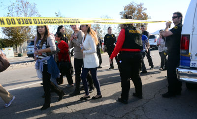 Survivors are evacuated from the scene of Wednesday's mass shooting under police and sheriff's escort in San Bernardino.