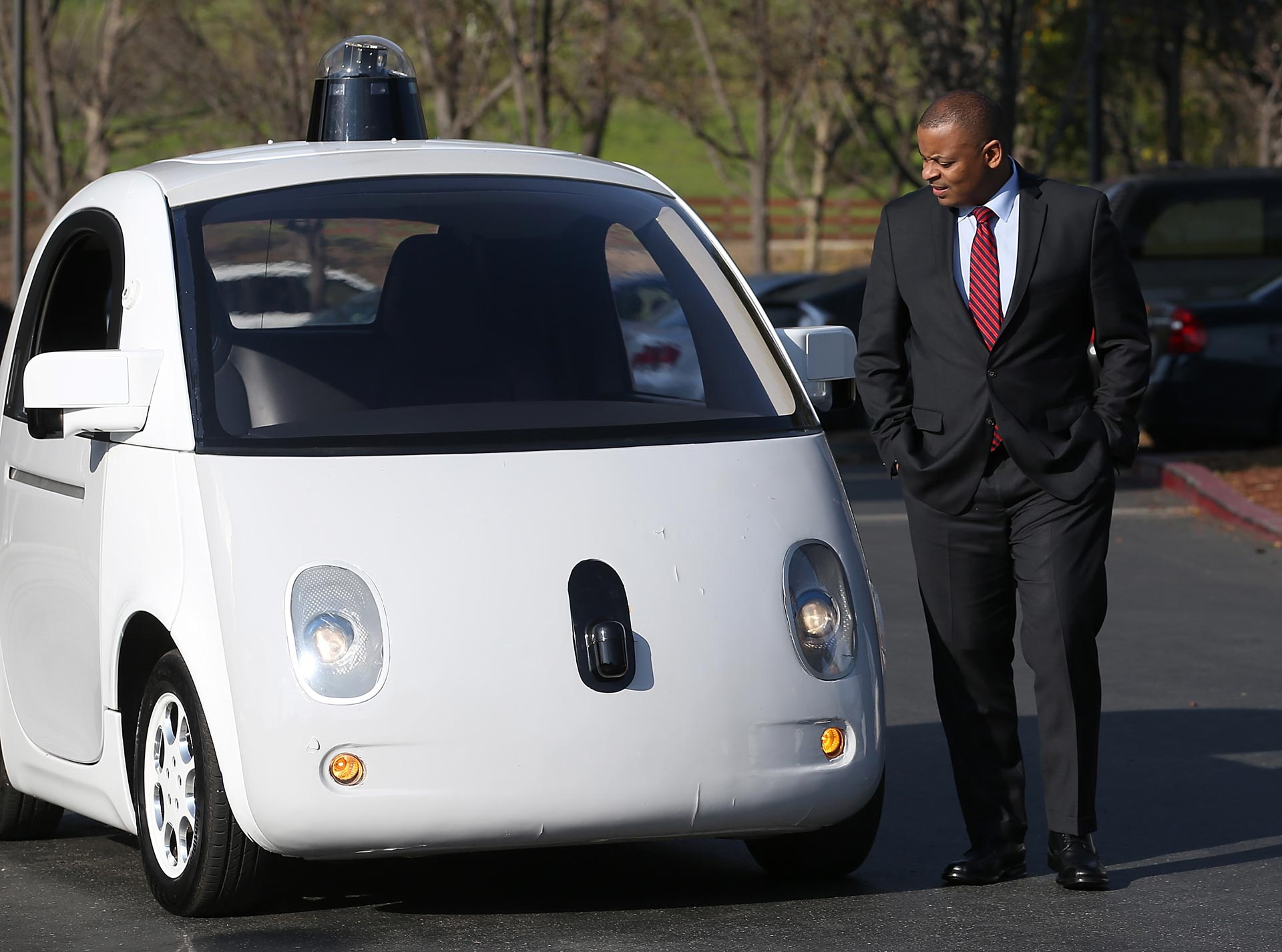 U.S. Transportation Secretary Anthony Foxx inspects a Google self-driving car at the Google headquarters on February 2, 2015.