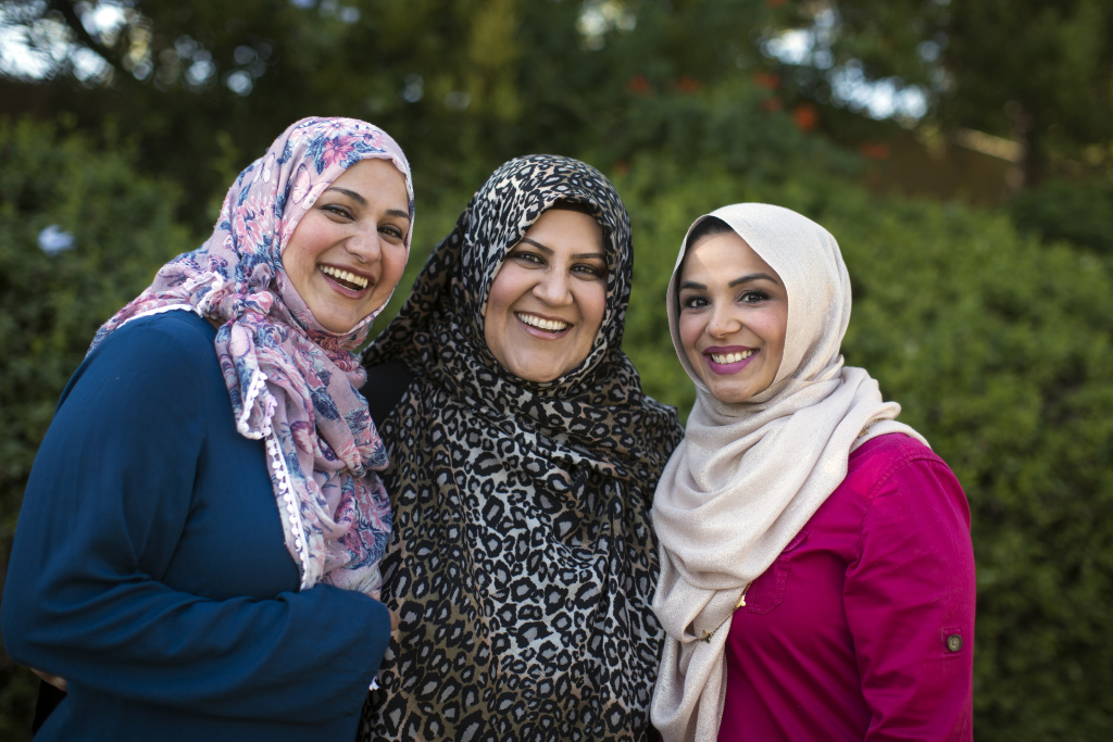 Maria Ahmed (L), Hosai Mojaddidi and Shahzia Rahman founded a co-op preschool together and are good friends. Ahmed and Mojaddidi have long worn hijab. Rahman is a practicing Muslim but did not wear hijab until recently. She decided to begin wearing it in hopes of doing her part to counter anti-Muslim prejudice.