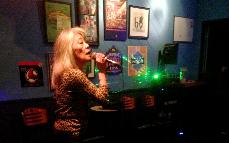 Deena Yagi sings at Nick's Karaoke Lounge, a bar located off of Adeline Street in South Berkeley.