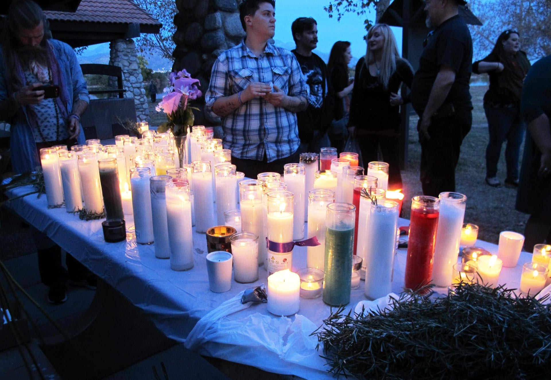 About 100 people gathered at the site of the Renaissance Pleasure Faire in Irwindale on Saturday for a candlelight vigil to remember San Bernardino shooting victim Larry Daniel Kaufman.