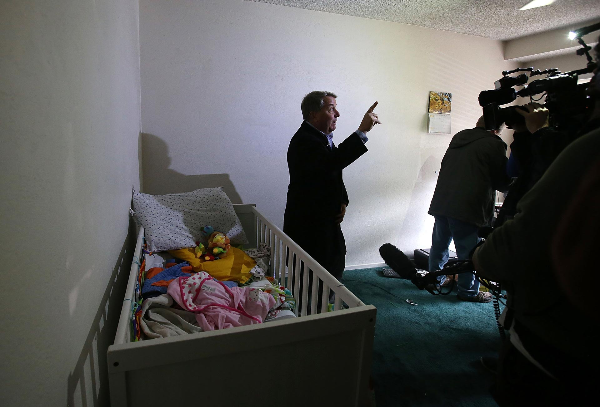 A reporter does a live shot inside the home of shooting suspect Syed Farook on Dec. 4, 2015 in San Bernardino.