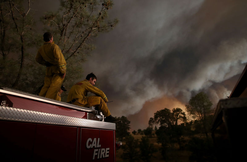 Cal Fire firefighters monitor the progress of the Rocky Fire on August 1, 2015 near Clearlake, California. Over 1,900 firefighters are battling the Rocky Fire that burned over 22,000 acres since it started on Wednesday afternoon. The fire is currently five percent contained and has destroyed at least 14 homes. (Justin Sullivan/Getty Images)