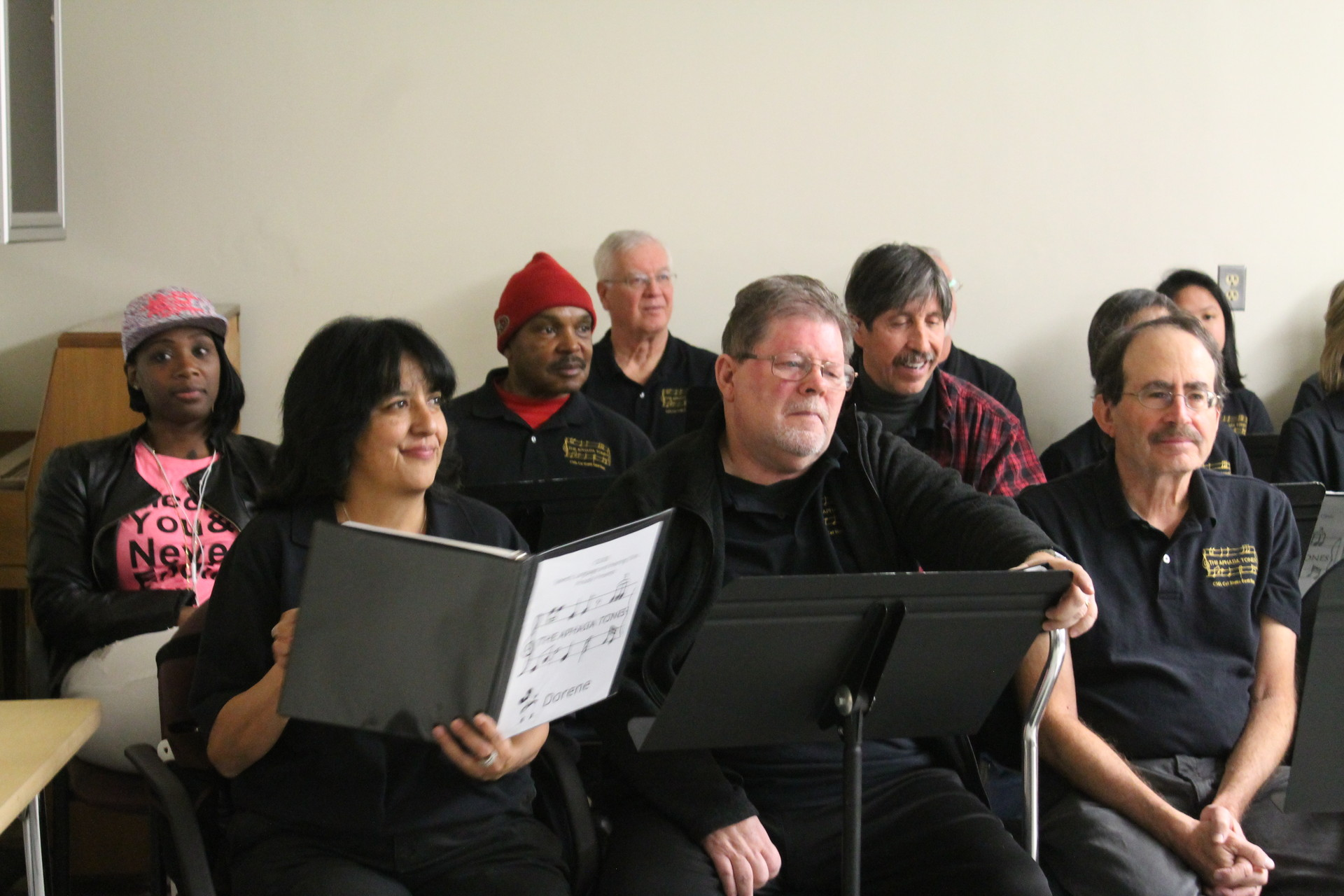 Members of the Aphasia Tones, a choir for people with aphasia, perform at their end-of-semester event at CSU East Bay in Hayward.