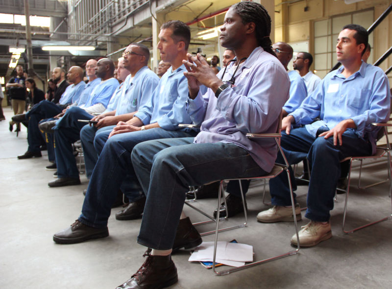 Code 7370's student inmates listen to introductory speeches on Demo Day prior to their projects' presentation at San Quentin.
