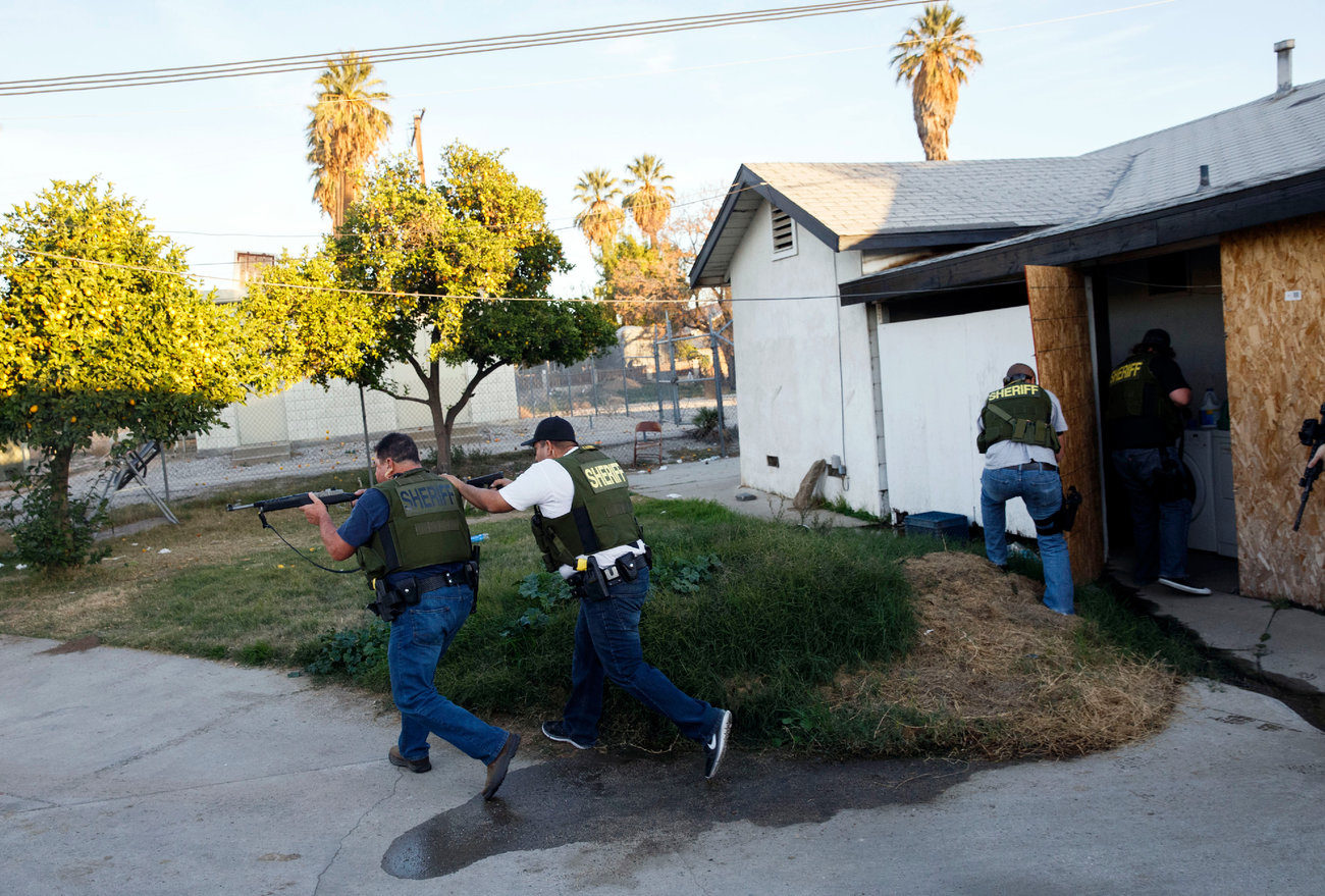 Authorities told people in a San Bernardino neighborhood to stay indoors as they searched the area.