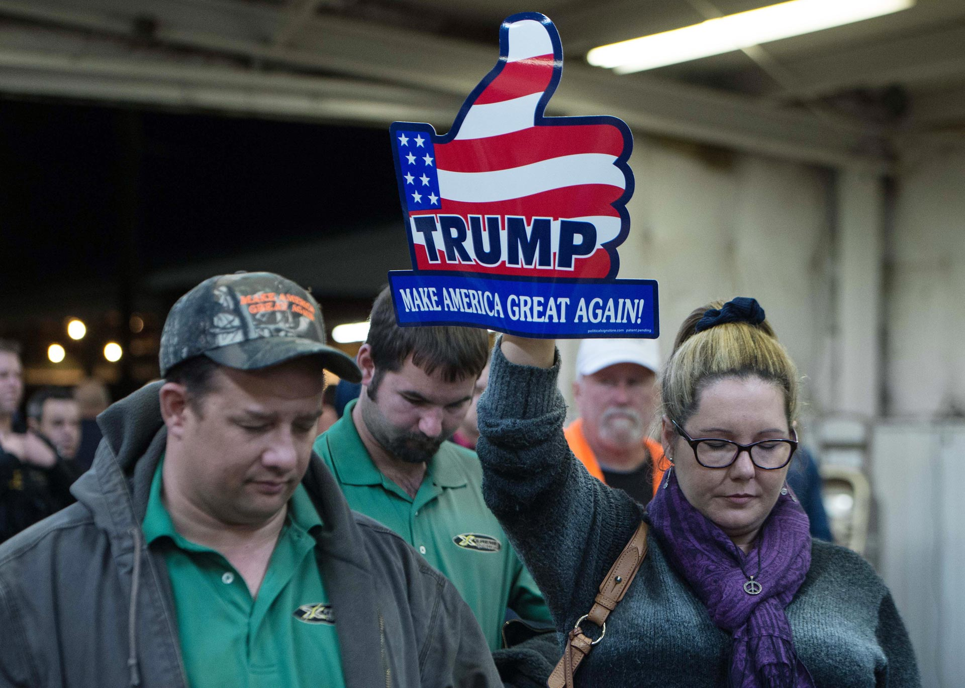 Attendees at a Donald Trump rally in Manassas, Va. take part in a prayer and moment of silence after the San Bernardino shootings on Dec. 2, 2015.