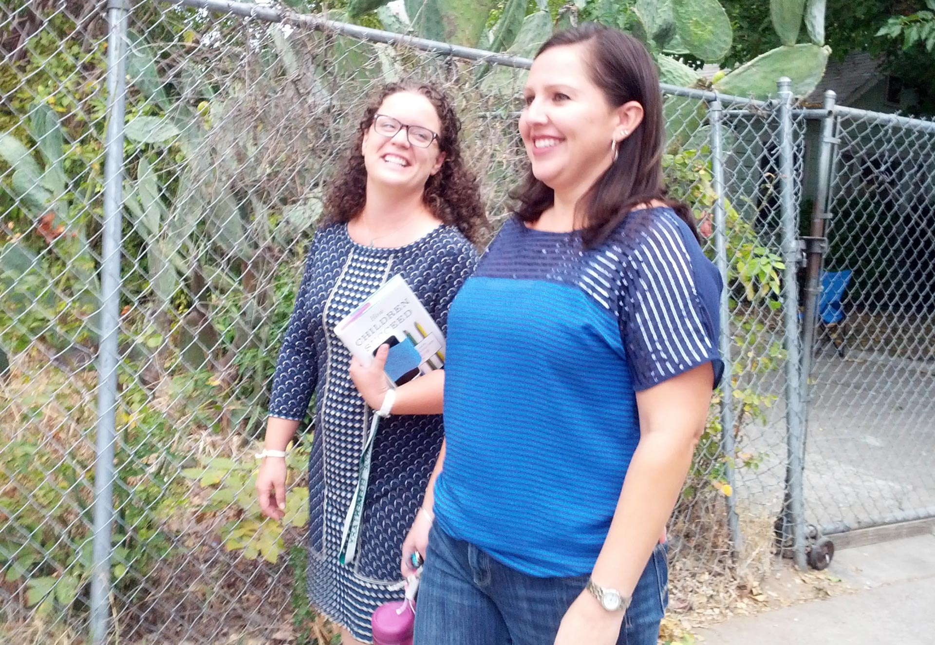 Teachers Stephanie Smith and Cristina Bautista walk to many of their students' homes.