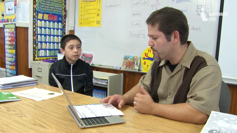 Third grade teacher Oscar Ramos works with his former student Jose Ansaldo. (Courtesy ITVS)