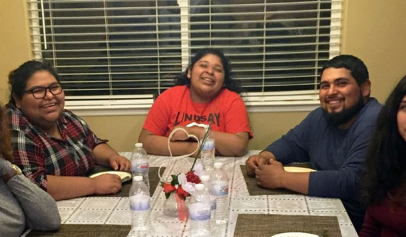 Amy Huerta (left), sister Katty and brother Luis Medellin and friends in Lindsay, CA. Amy is the only member of her immediate family who can vote, but doesn't. Her brother Luis is trying to change that.