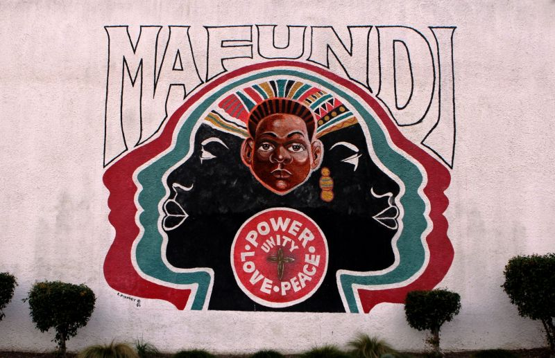 The Mafundi Institute mural on 103rd street in Watts. The historic building, long a hub of local arts and activism, is now home to the Mafundi auditorium and the Watts Coffee House and restaurant