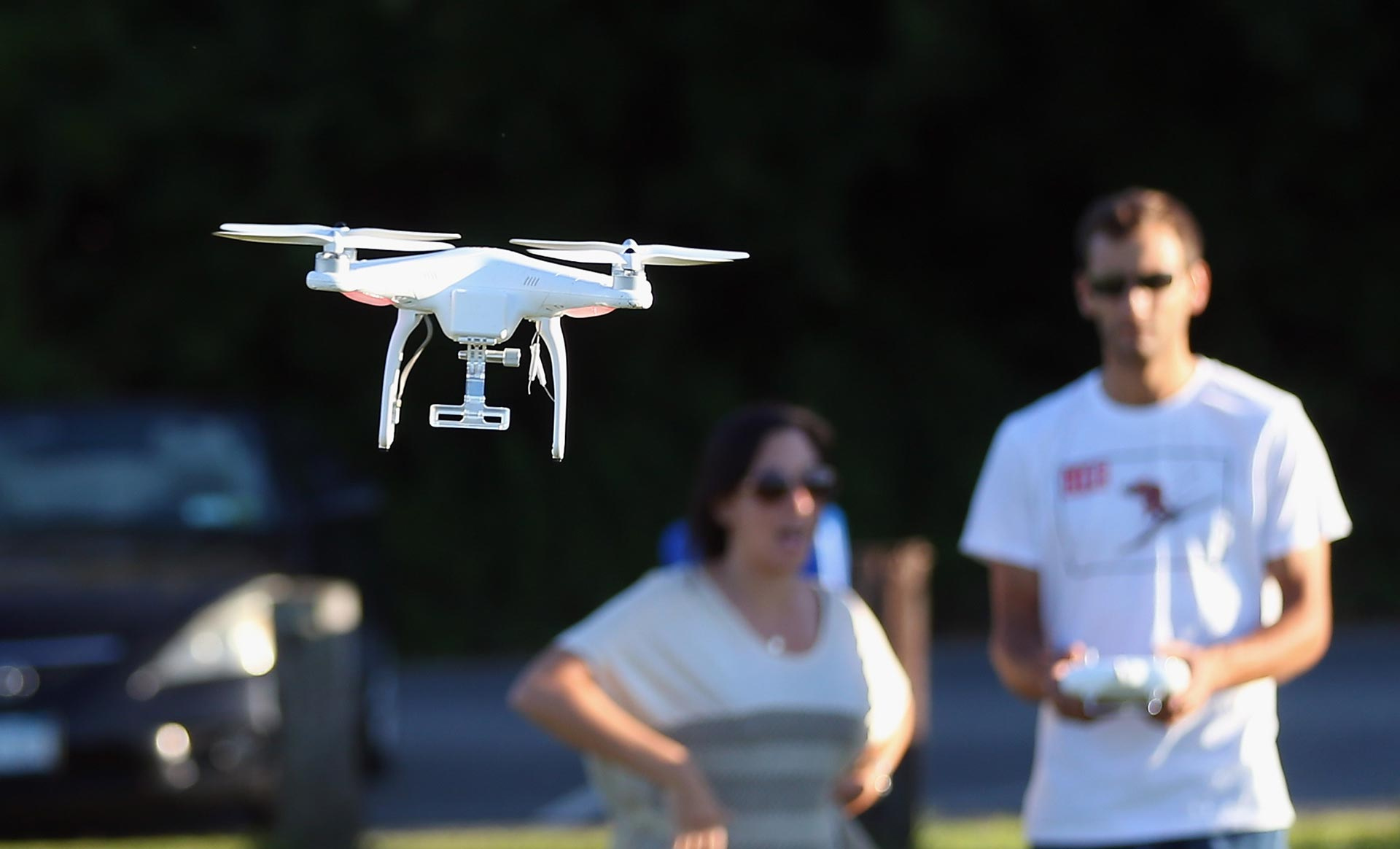 An enthusiast flies a recreational drone.
