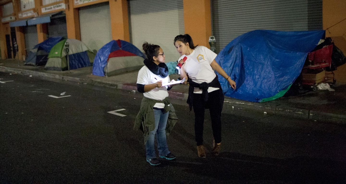 Thousands of people have fanned out across L.A. County this week for the region's three-day homeless count. That includes tallying the scores of people living on the streets of downtown's Skid Row, pictured here as volunteers conduct the 2015 homeless count. David McNew/Getty Images