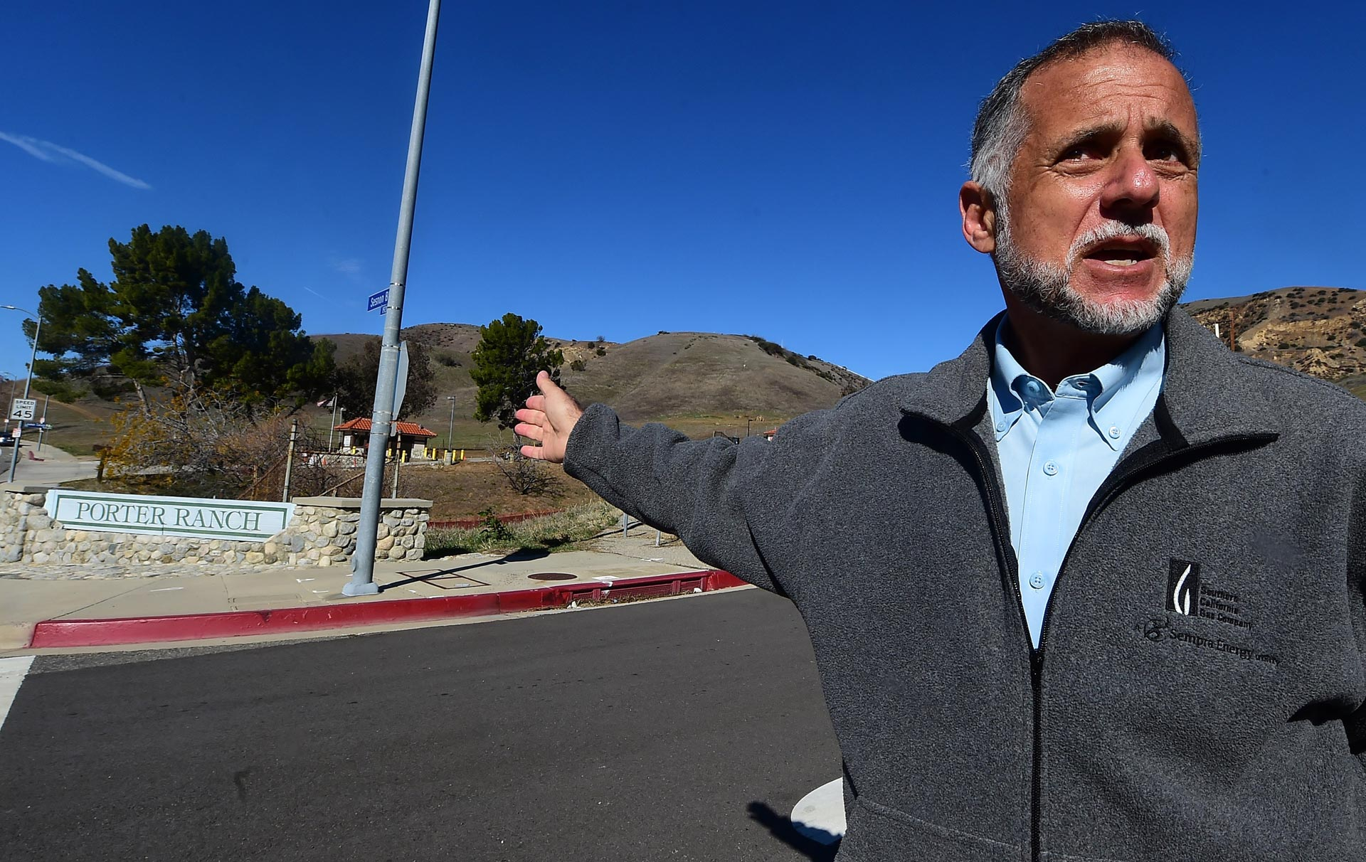SoCalGas spokesman Mike Mizrahi gestures while describing the flow of wind outside the company's Aliso Canyon storage facility in Porter Ranch.