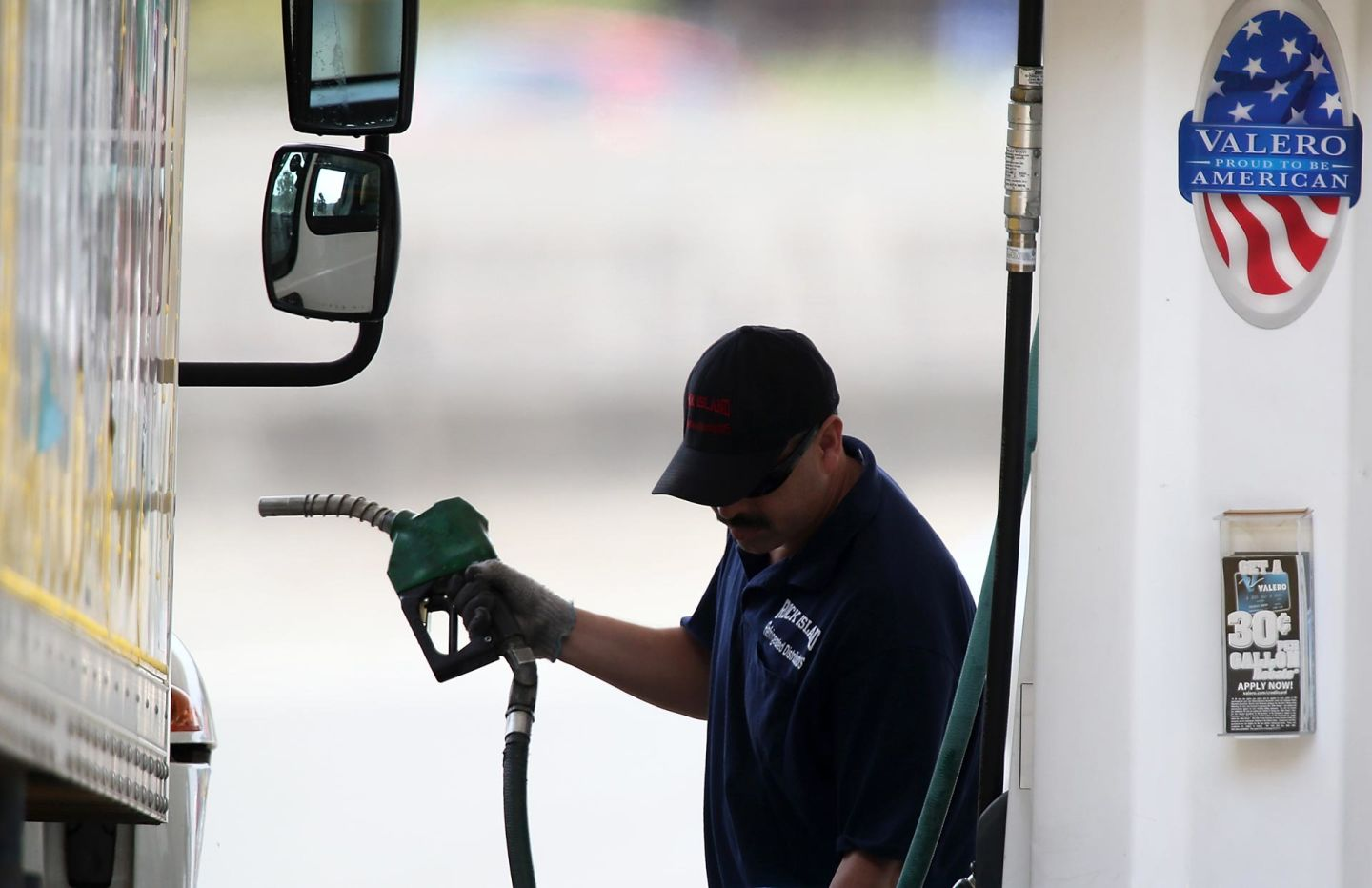 A customer prepares to pump gas into his truck at a Valero gas station in Mill Valley.