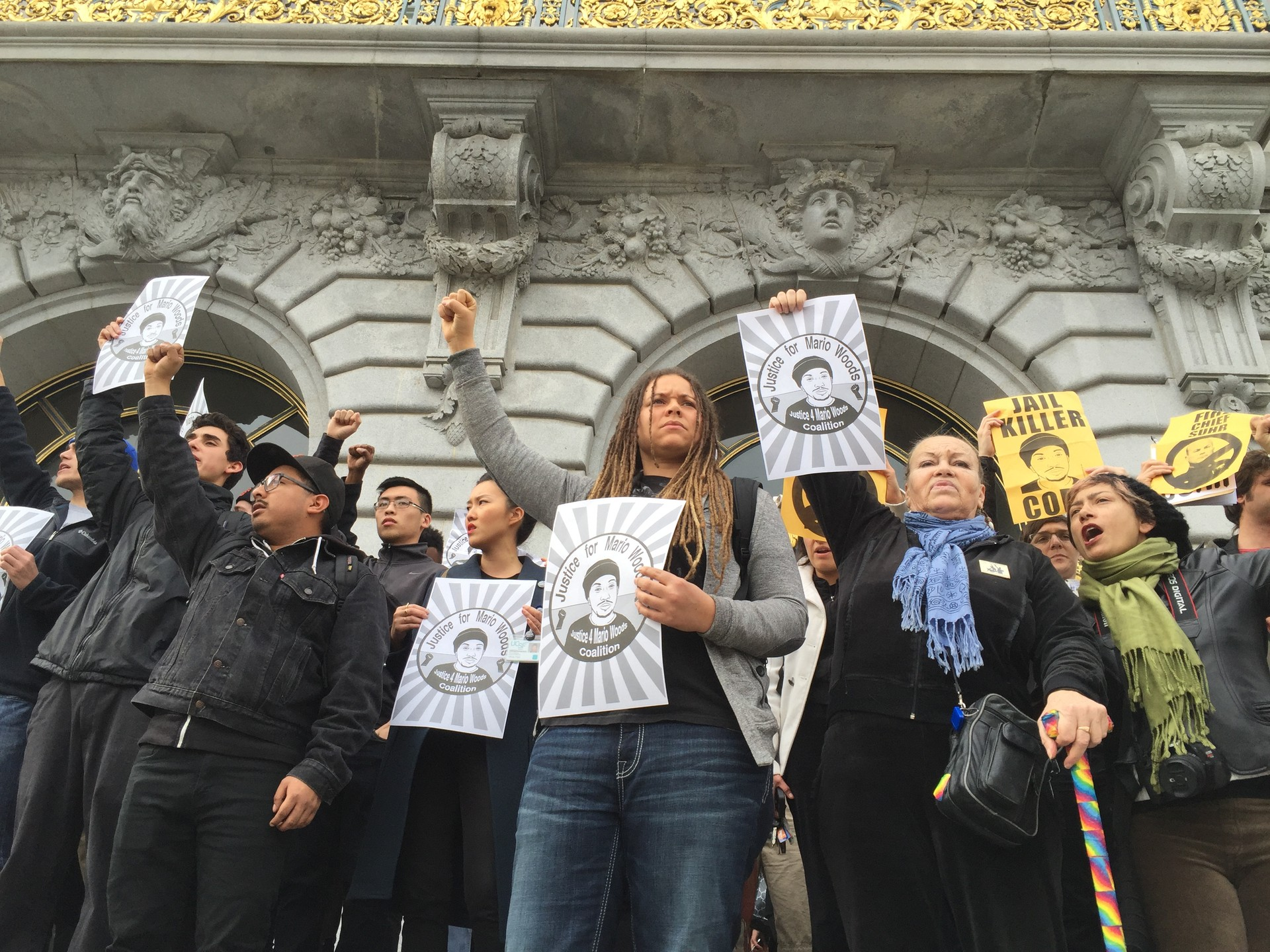"Members of the Justice for Mario Woods Coalition gathered outside San Francisco City Hall after shouting at Mayor Ed Lee to ""fire Chief Suhr"" during his inauguration speech Friday."