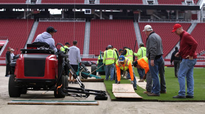 Two dozen crew members lay down the new Super Bowl turf at Levi's Stadium.
