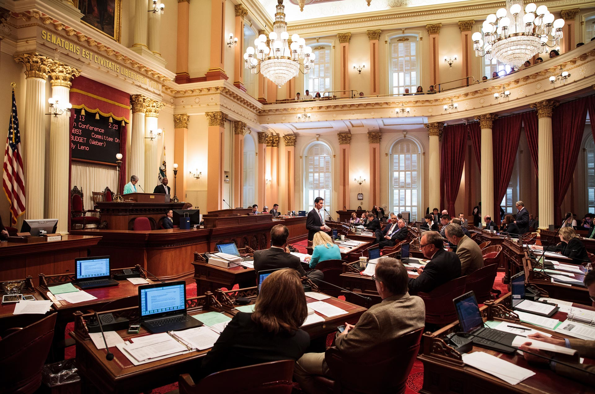 State senators meet in the California Senate chambers in Sacramento.