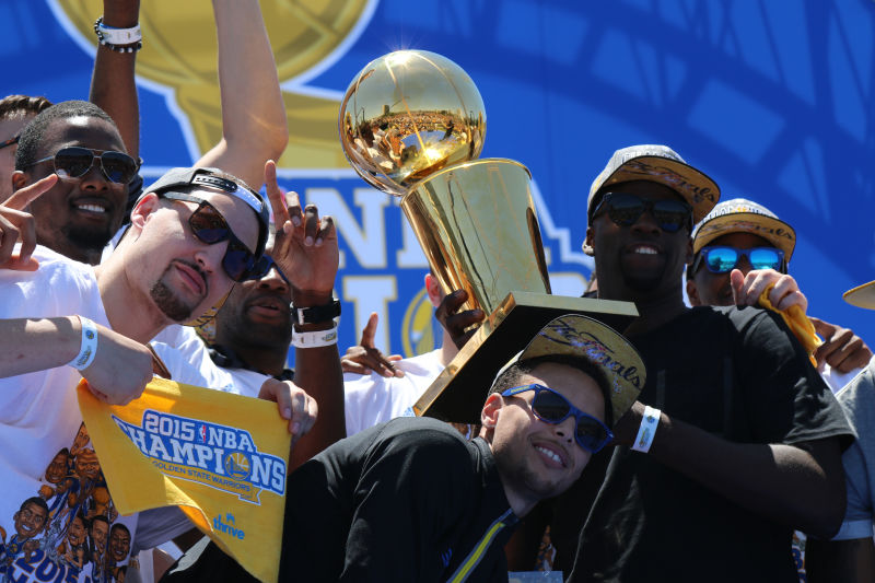 Green and teammates celebrate at the championship parade in Oakland last June. (Adam Grossberg/KQED)