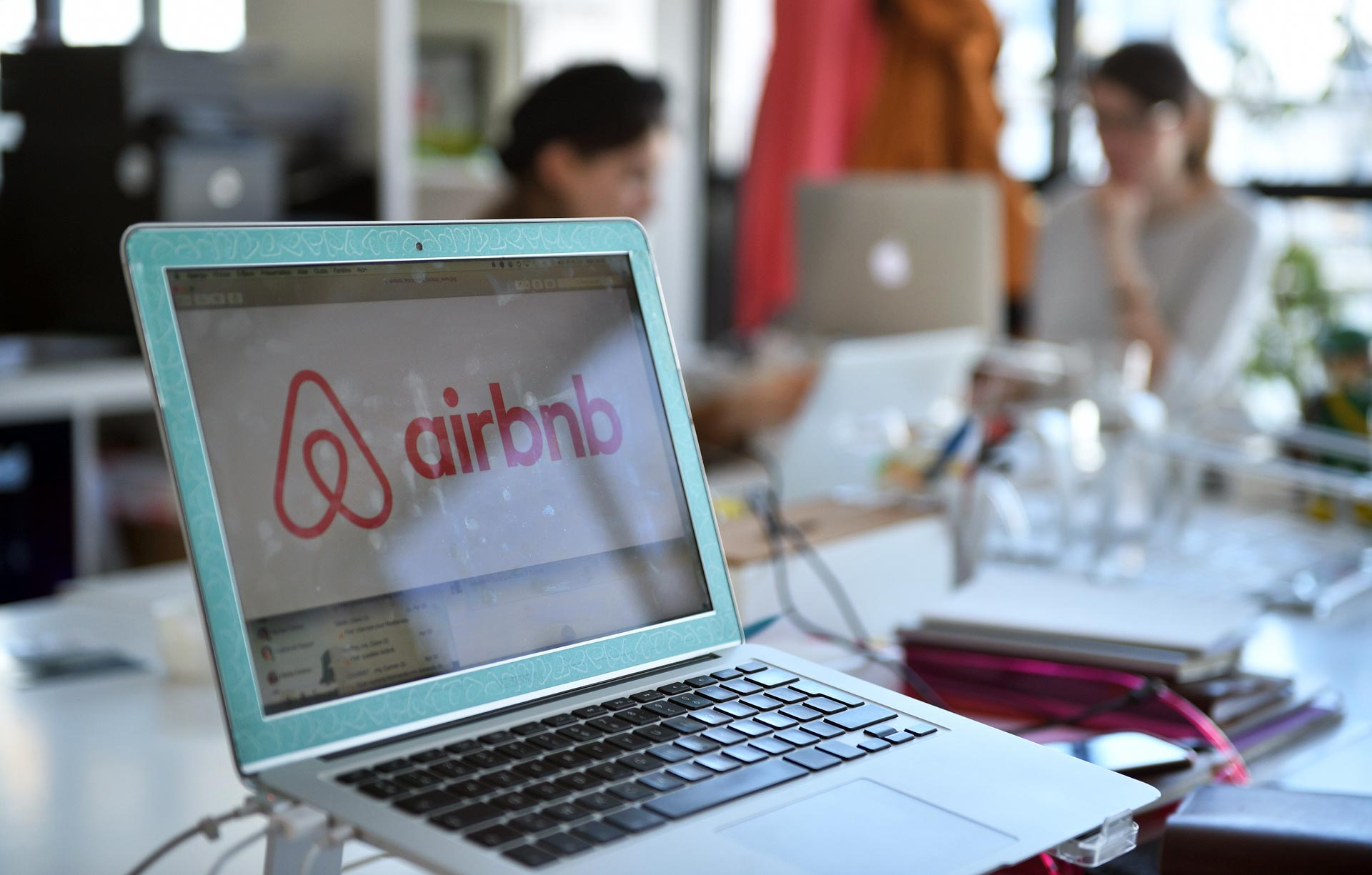 A laptop shows the logo of Airbnb at the company's offices in Paris.