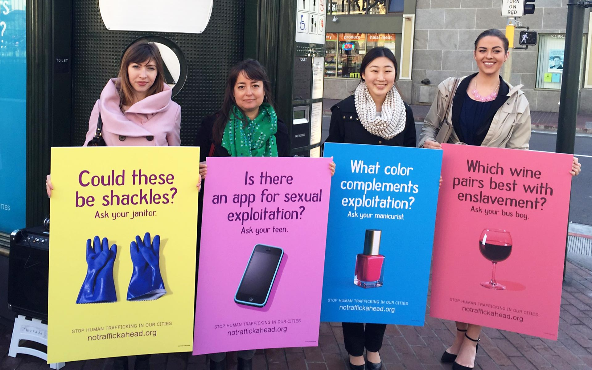 Public policy fellows with San Francisco's Department on the Status of Women hold mock-ups of anti-trafficking billboards.