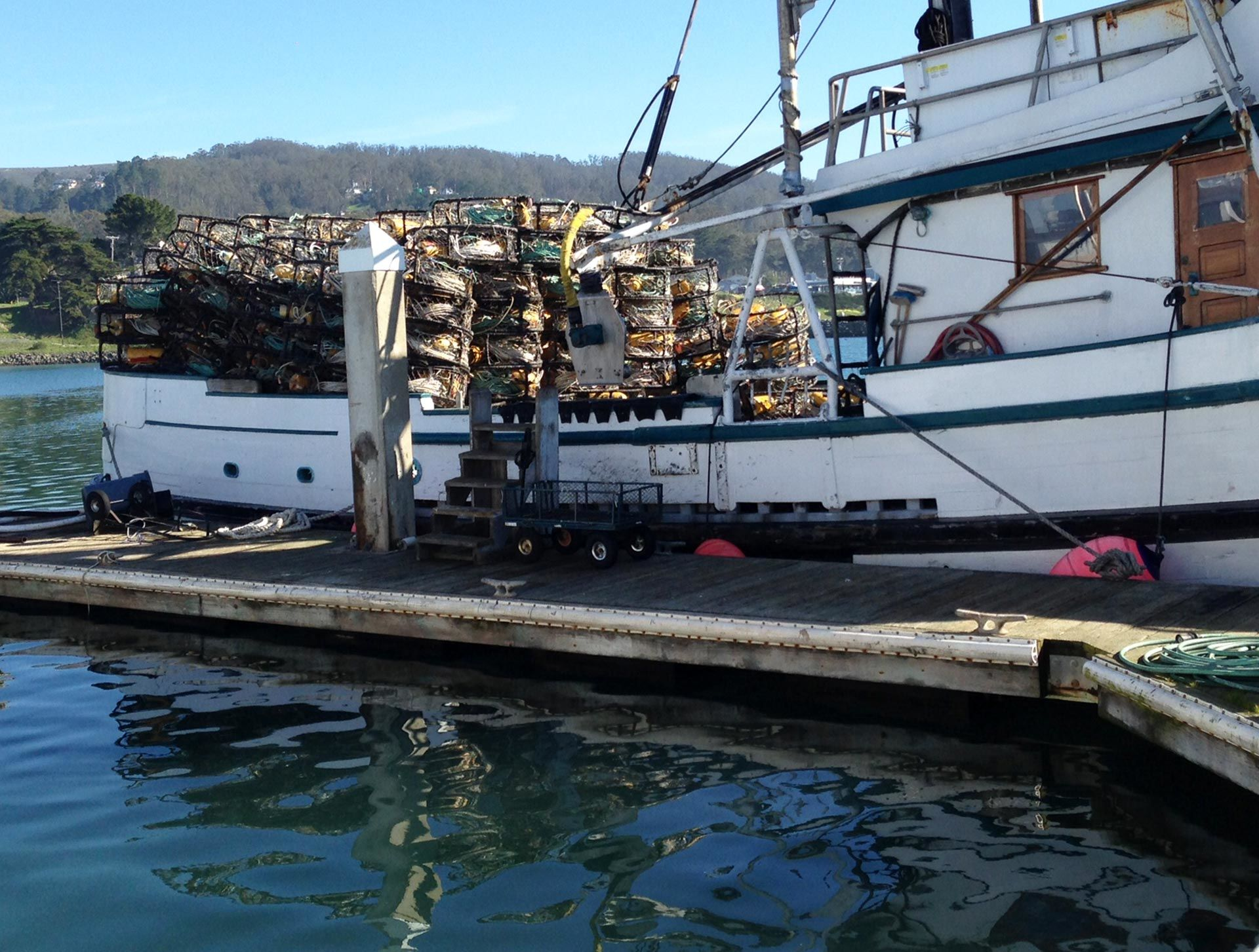 Crab pots sit unused on a fishing boat in Half Moon Bay harbor. Adia White/KQED