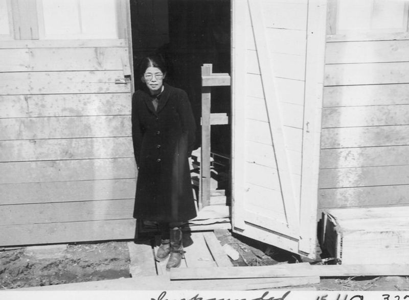 A Japanese woman in the door of her living quarters in San Bruno.