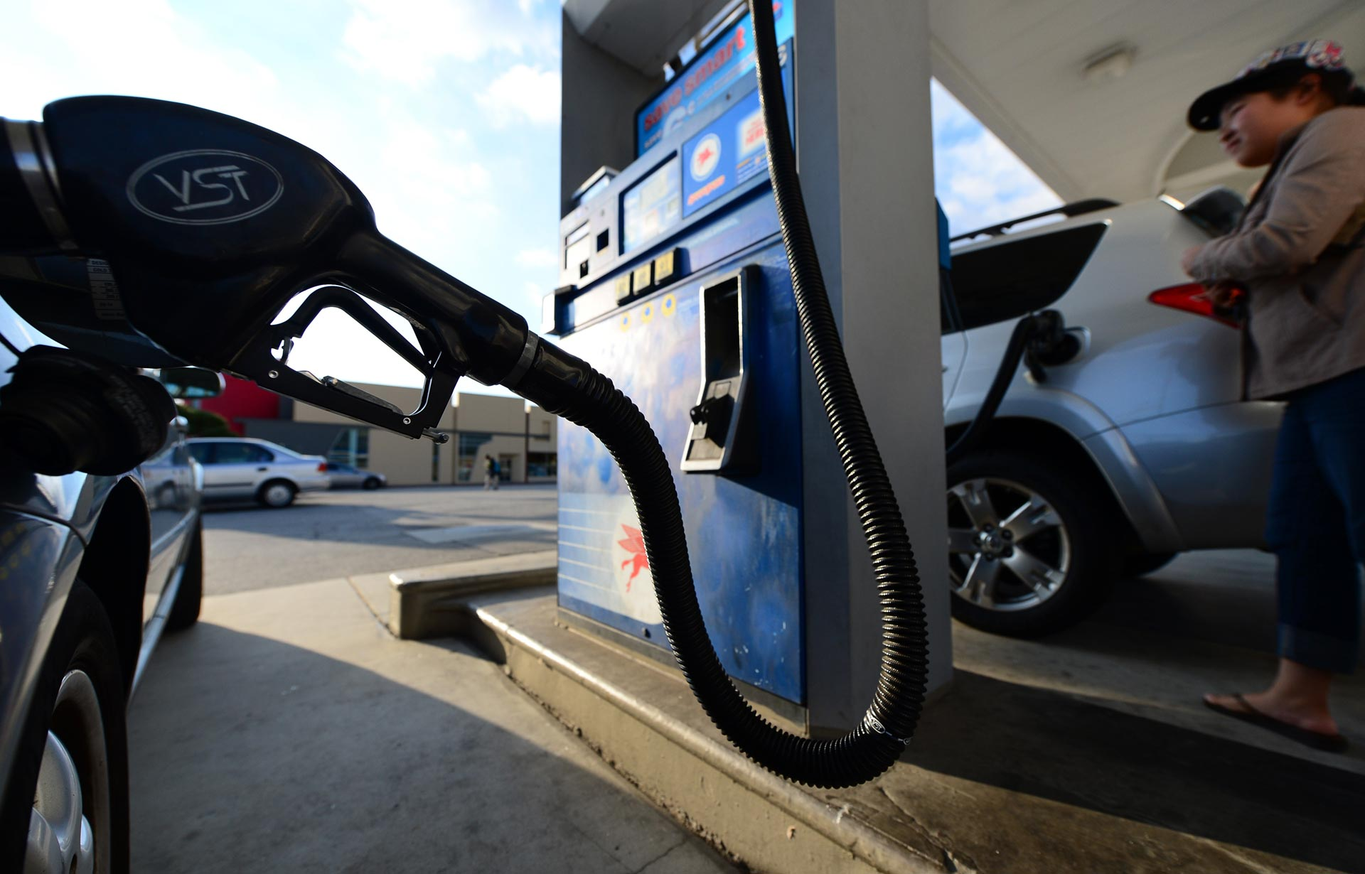A driver fills up her tank in Los Angeles.