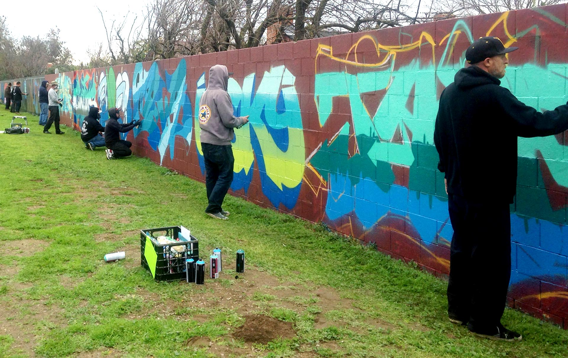 A crew of graffiti artists called Lords paint a quarter-mile-long wall to pay homage to their founder, Bizare.