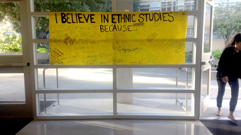 "A hand-written poster that says ""I believe in ethnic studies because..."" is displayed at the front entrance at the College for Ethnic Studies Building at SFSU, February 24, 2016, with signatures and notes like ""Don't cut my history!"" written on it."