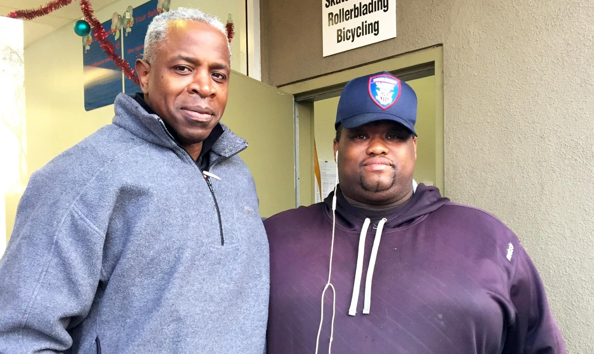 Joseph Latichinson (R) stands with his boss, Wayne Robertson, in San Francisco. Latichinson works full-time but can't afford a place to live.