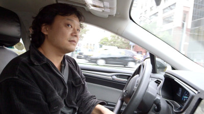 John Han has been a cab driver in San Francisco for 13 years. (Adam Grossberg/KQED)