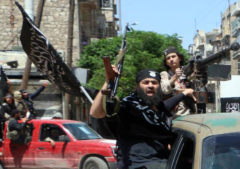 Fighters with the al-Nusra Front drive in the Syrian city of Aleppo, flying Islamist flags in 2015. For gay refugees like Nahas, they were even worse than the Assad regime.