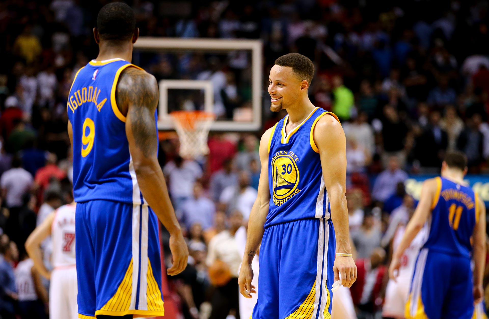 Stephen Curry laughs with Andre Iguodala during a game against the Miami Heat on Feb. 24, 2016.