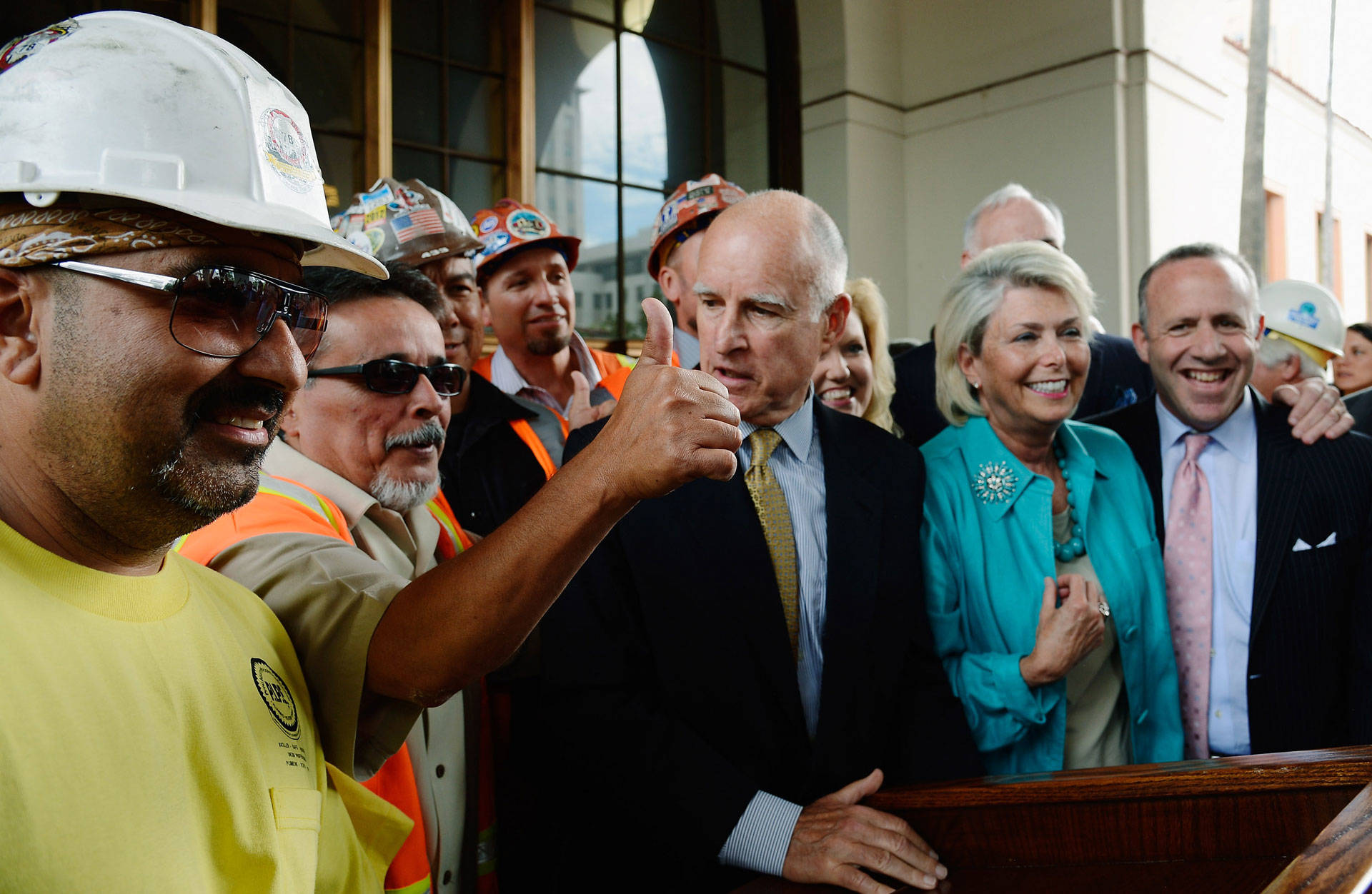 Gov. Brown, surrounded by construction workers and elected officials, speaks after signing legislation authorizing initial construction of California's high-speed rail line on July 18, 2012 in Los Angeles.