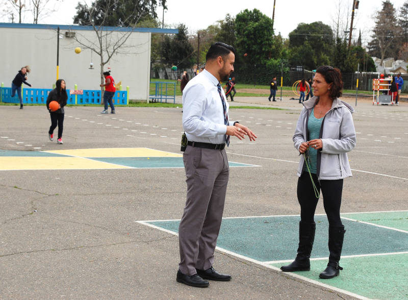 Principal Daniel Rolleri checks in with the school's behavioral specialist during recess at Oak Ridge Elementary.