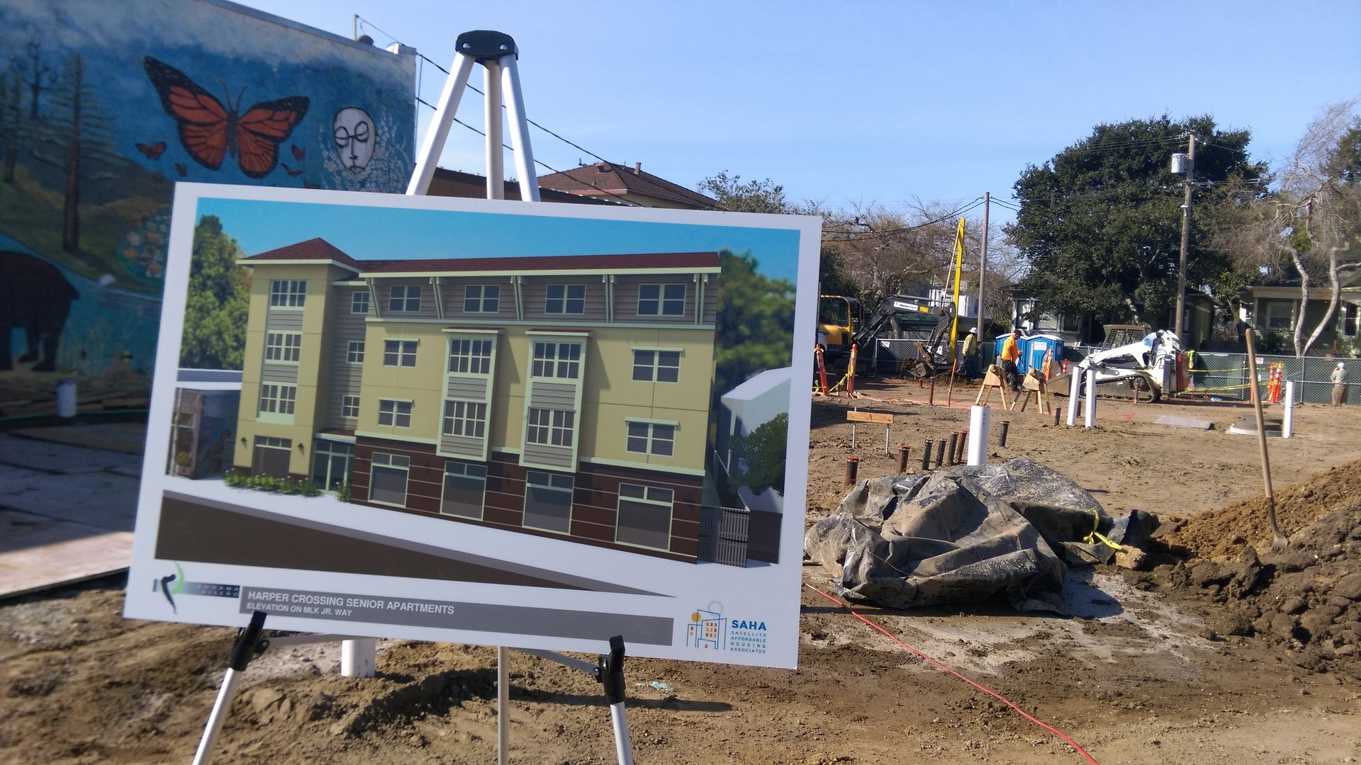 A sign shows the design for Harper Crossing, a new affordable housing structure for seniors near the Ashby BART station.