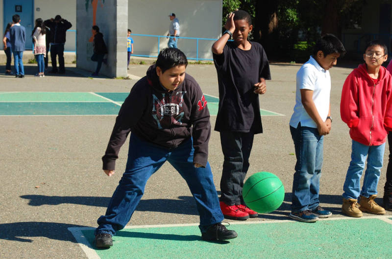 Carlos Delrio plays four square with his classmates at recess.