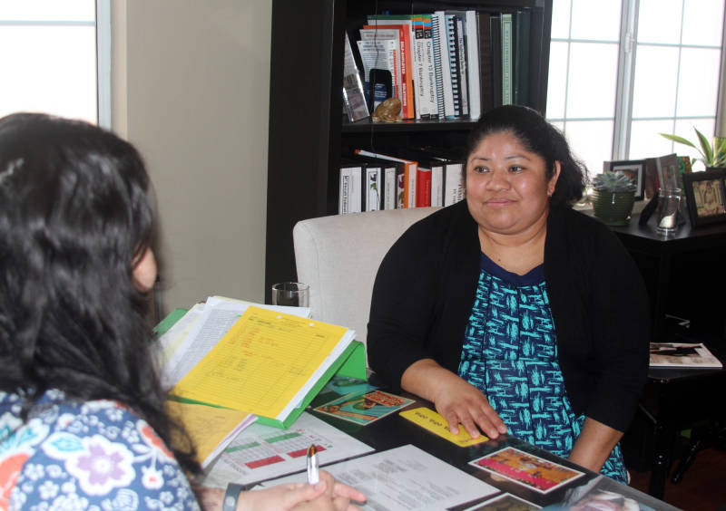 Pablo Aguilar's mother Evelyn meets with Mercedes Castillo, an immigration lawyer in East Los Angeles on Feb. 8, 2016.