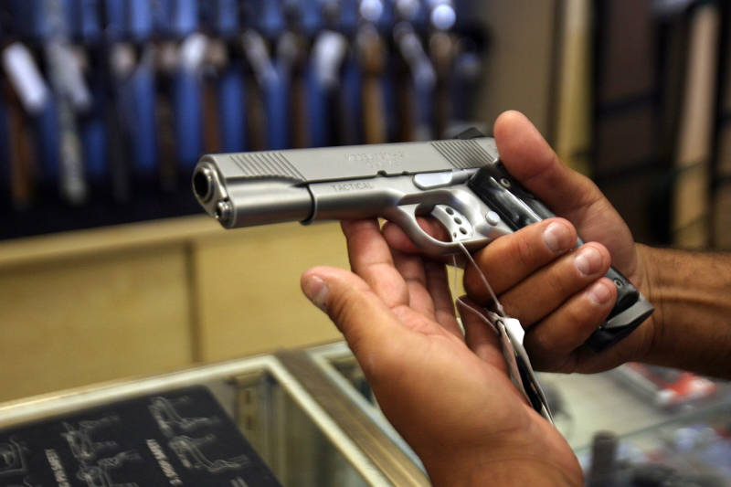 A customer shops for a handgun at the Gun Gallery in Glendale.