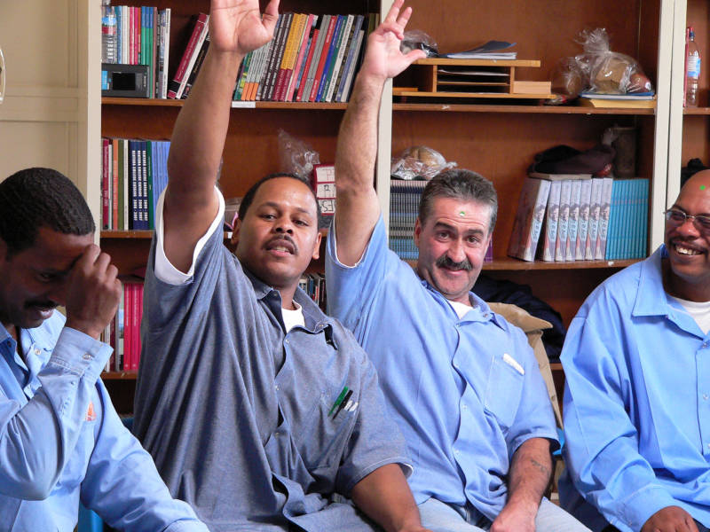 Inmates including Sam Lewis (second from left) participate in an alternatives to violence workshop at Soledad Prison.