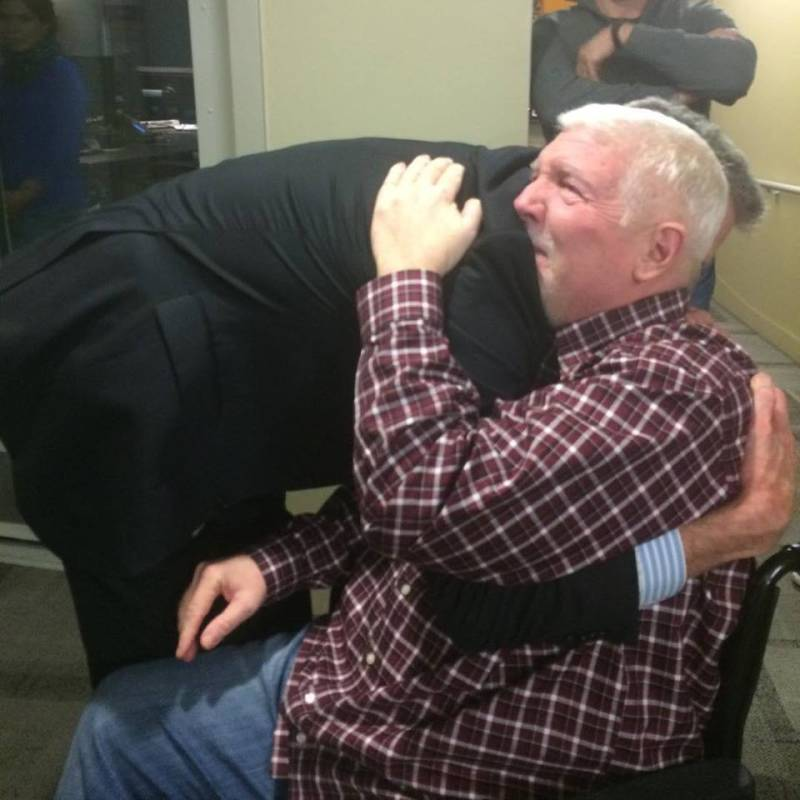 Steve Julian of KPCC in Los Angeles gets a studio named after him, and a great, big hug from President and CEO Bill Davis.